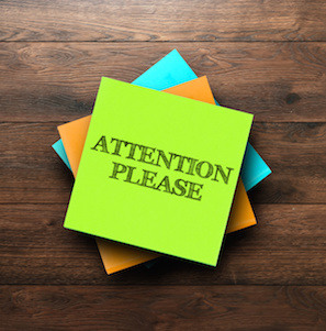 Image of Post-It note saying Attention Please
