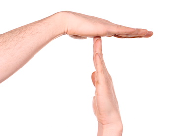 Image of two hands making a time-out sign