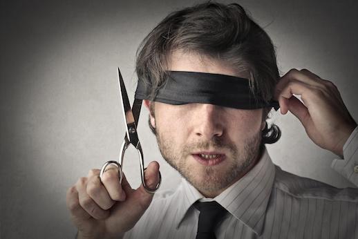 Image of man removing blindfold