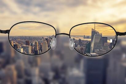 Image of glasses clarifying the New York skyline