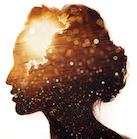 Image of sun emerging from clouds inside a woman's mind