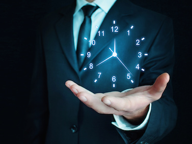 Image of a man holding a clock in his hand