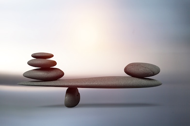 Image of rocks balancing on two sides of a plane