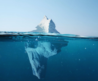 Image of iceberg with large portion hidden under water
