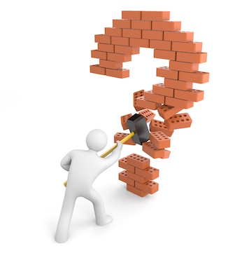 Image of a man breaking through a question mark made of bricks