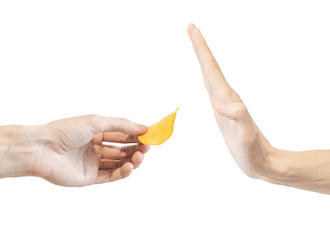 Image of hand held up to decline a potato chip