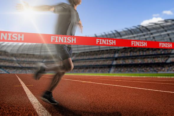 Image of runner crossing finish line