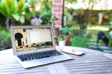 Image of laptop on picnic table in backyard