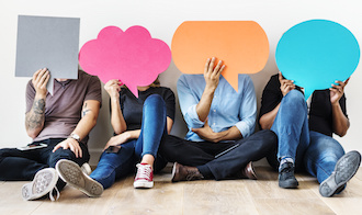 Image of people with diversely colored and shaped speech bubbles over their faces