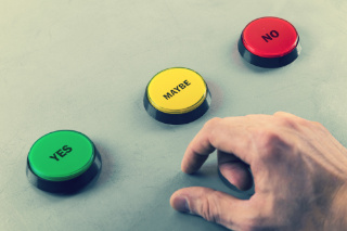 Image of hand approaching buttons