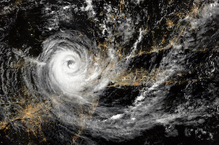 Image of aerial view of hurricane over northeastern United States at night. New York City and Newark, New Jersey. Long Island.