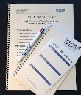 Image of The Thinker's Toolkit complete package with printed bound version of document, mental cleanup stickies, notepad and 4-color pen