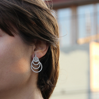 Image of close up of beautiful woman wearing a shiny hooped earring