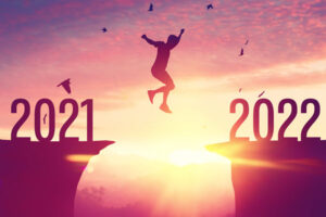 man jumping from 2021 to 2022
